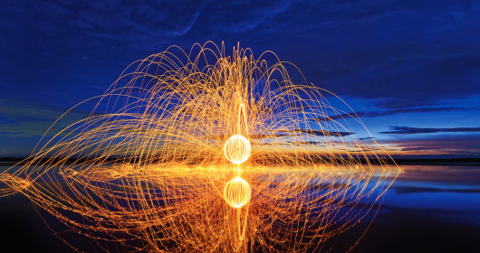 An image of a fireball on a lake