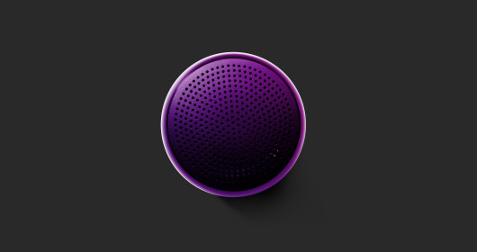 purple bluetooth speaker on gray surface