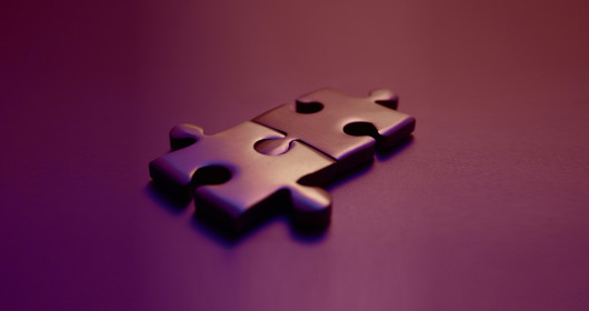 Puzzle pieces interlocking with purple background