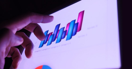 Close-up of hand in front of digital bar graph