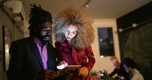 two young professionals using a tablet