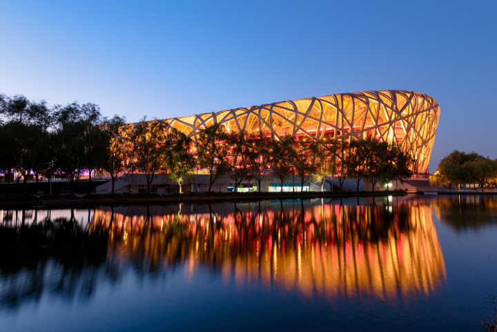 Visit the Beijing National Stadium, pictured here at night, on a tour of China