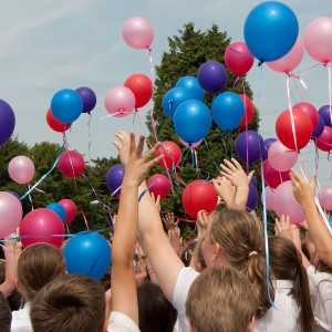 School children flying balloons
