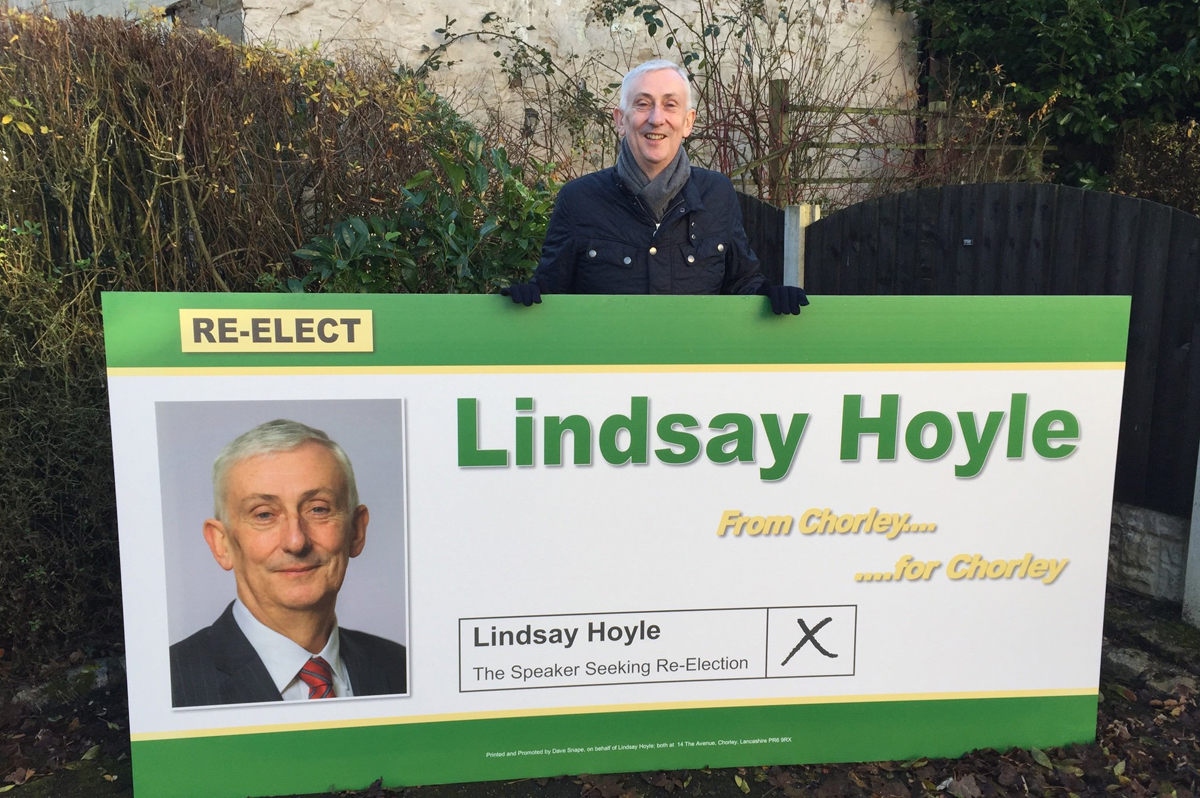 Speaker of the House of Commons, Lindsay Hoyle, holds a sign campaigning for re-election