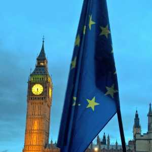 The EU flag in the foreground and Big Ben in the background during a protest in Parliament Square, Westinster.