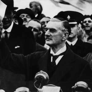 Neville Chamberline waving a copy of the Munich Agreement