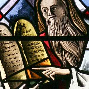 Stained glass showing Moses holding the Tablets of Stone
