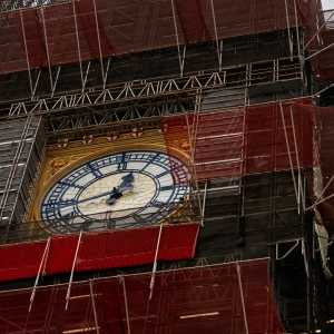 "Scaffolding surrounding the clockface to the The Queen Elizabeth tower (""Big Ben""), Houses of Parliament, Westminster"