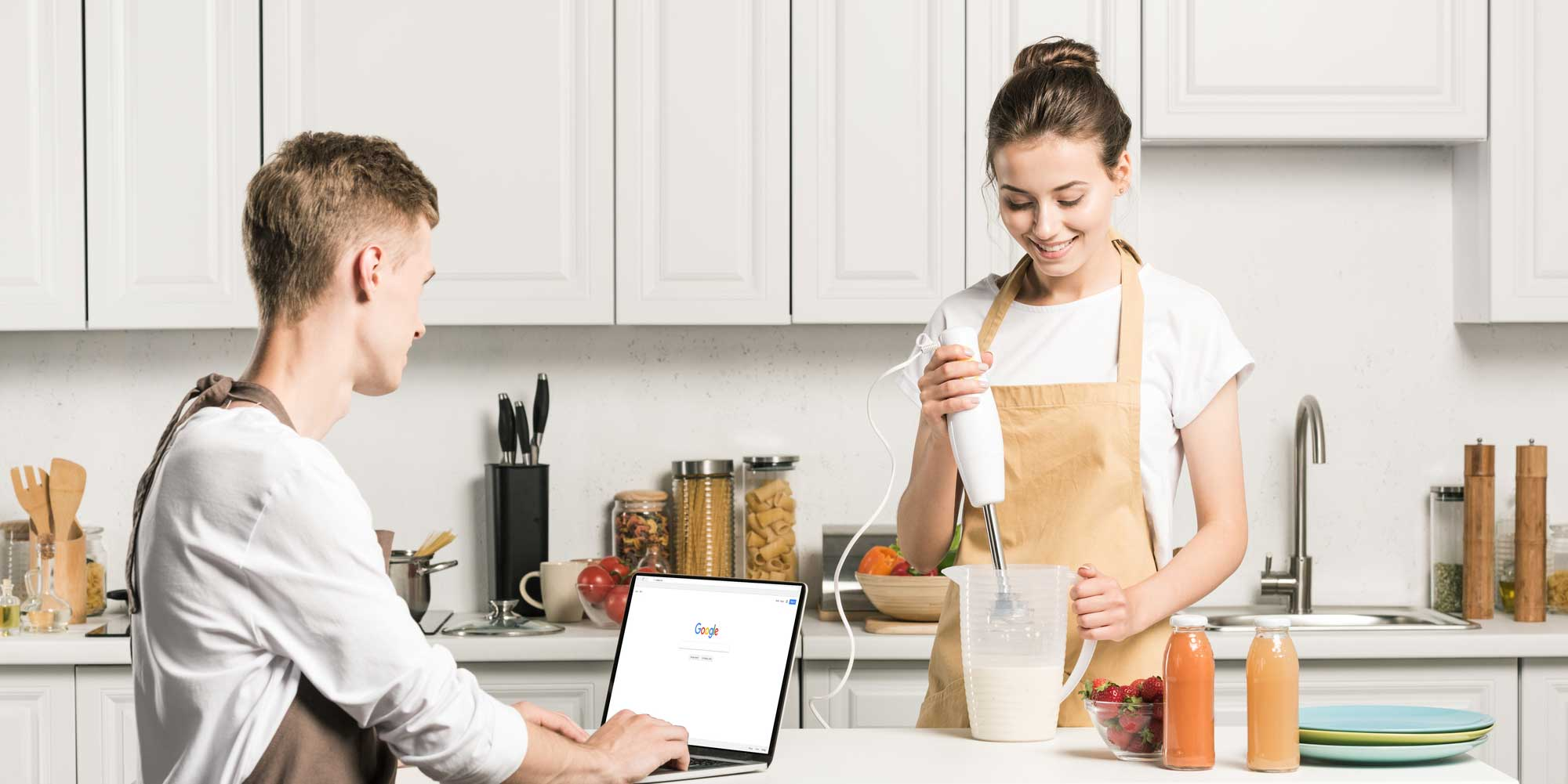 people-making-meal-with-laptop