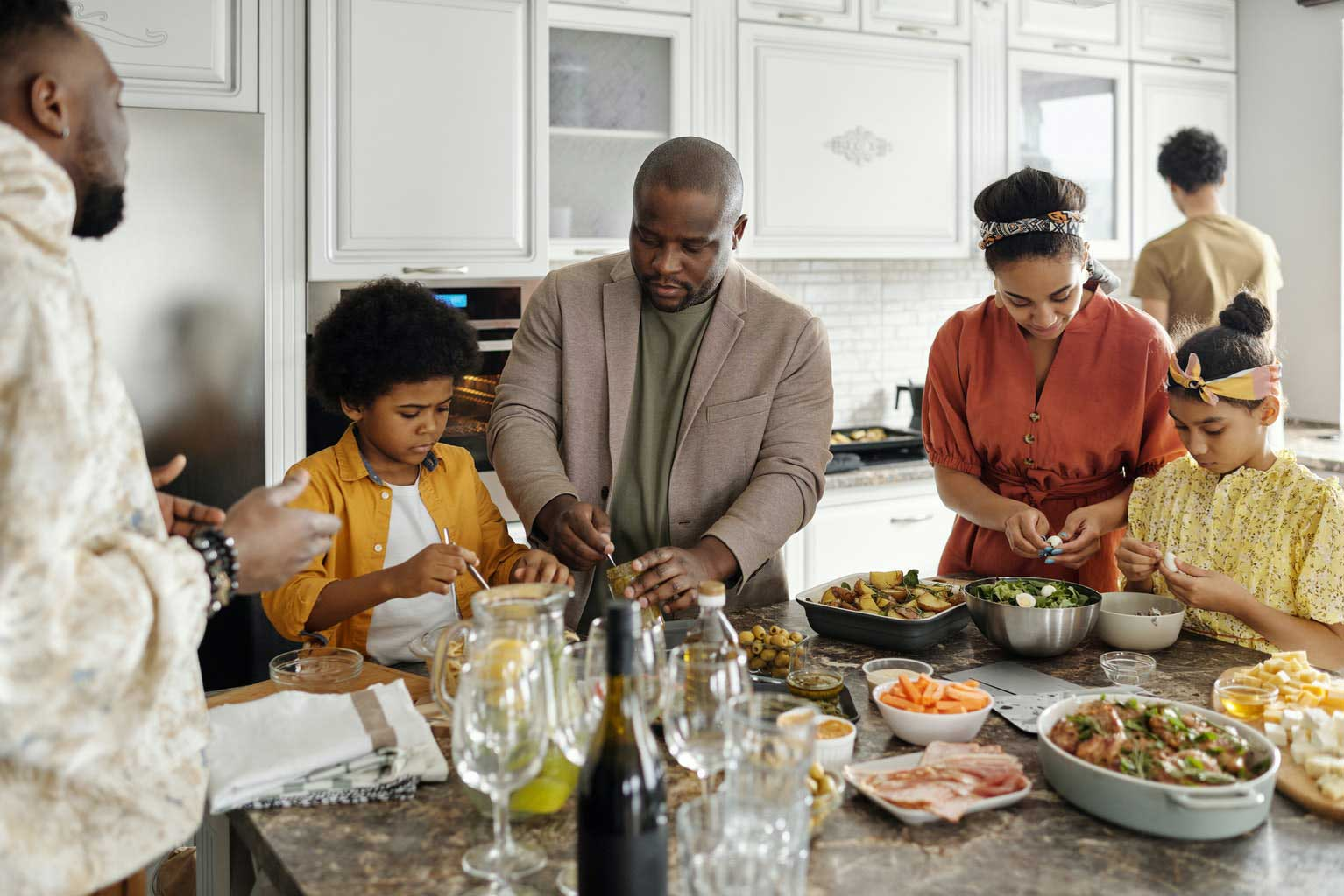 family-preparing-food-at-kitchen-table