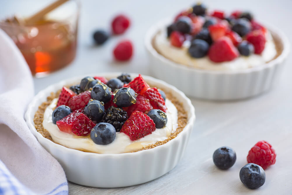Yogurt and berry breakfast tarts with granola