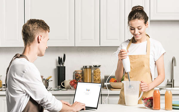 man-and-woman-cooking-with-laptop
