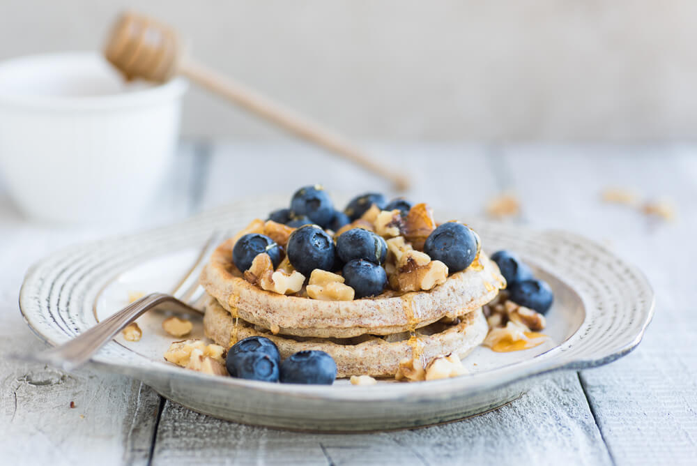 Whole wheat waffles with blueberries and walnuts
