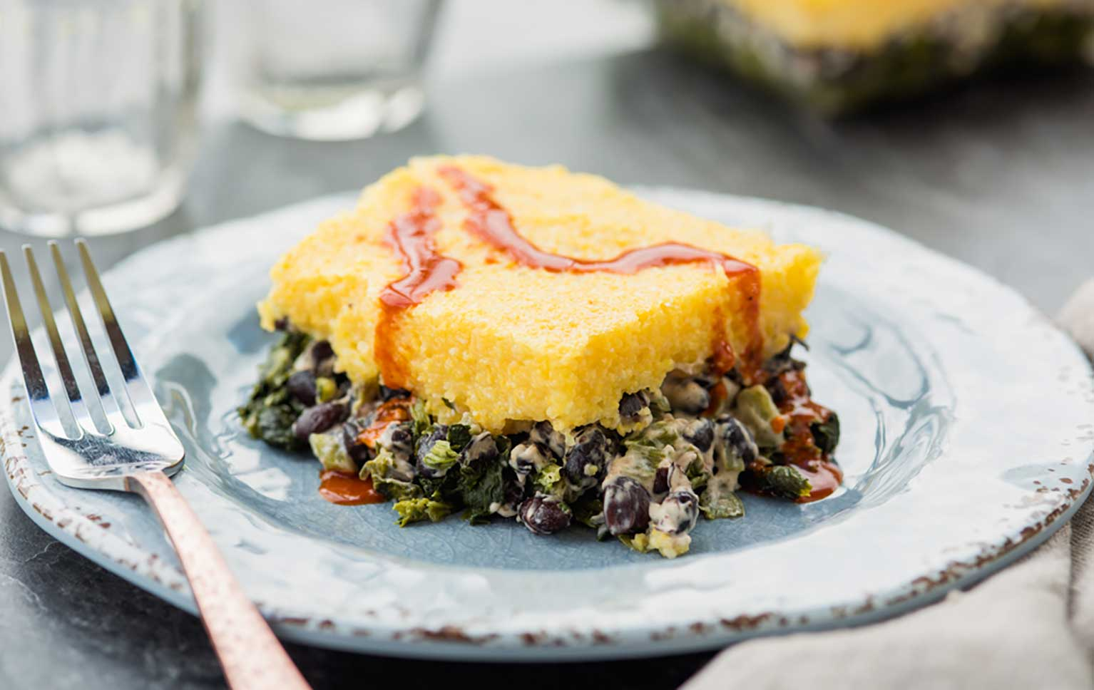 Polenta-and-black-bean-casserole-on-a-dish-with-a-fork