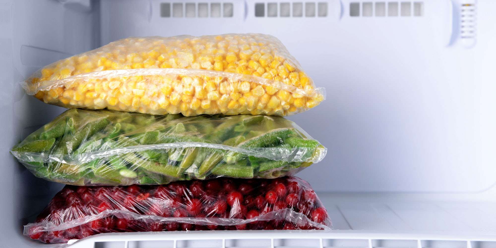 freezer bags with frozen corn beans and cranberries