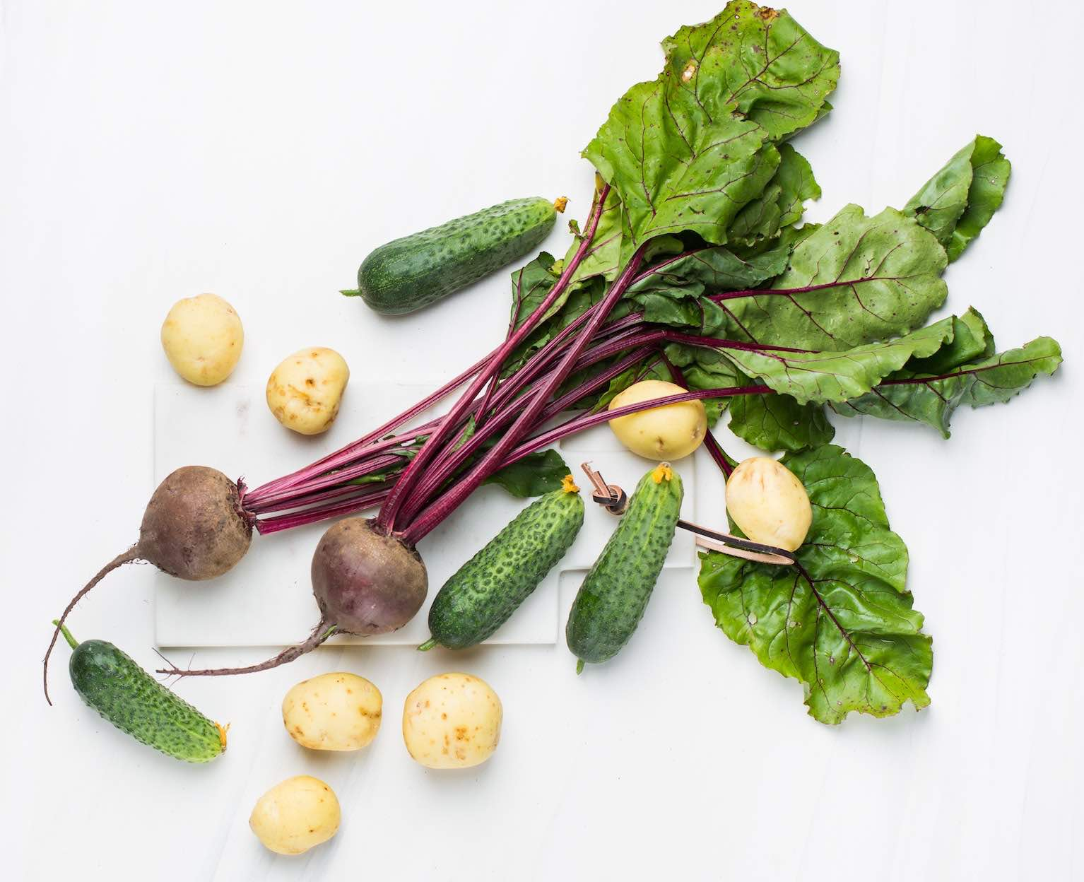 Assortment of beets, potatoes and cucumbers