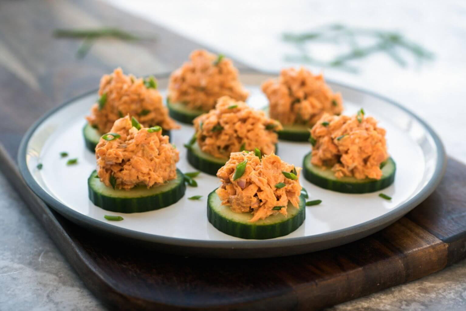 spicy salmon and cucumber sandwiches on a plate