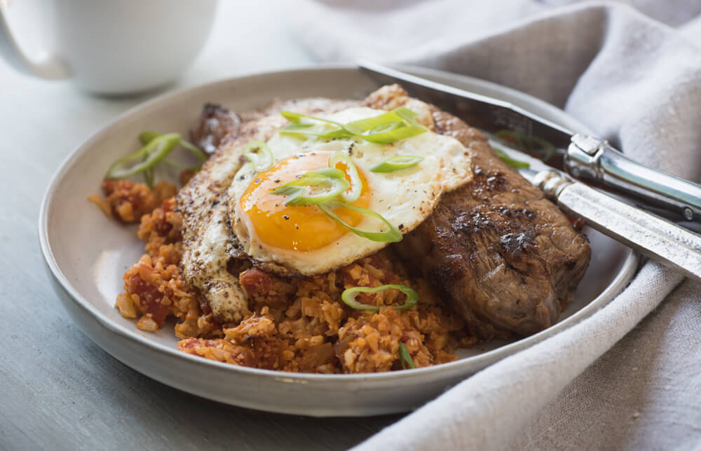 Steak and eggs with tomato cauliflower rice
