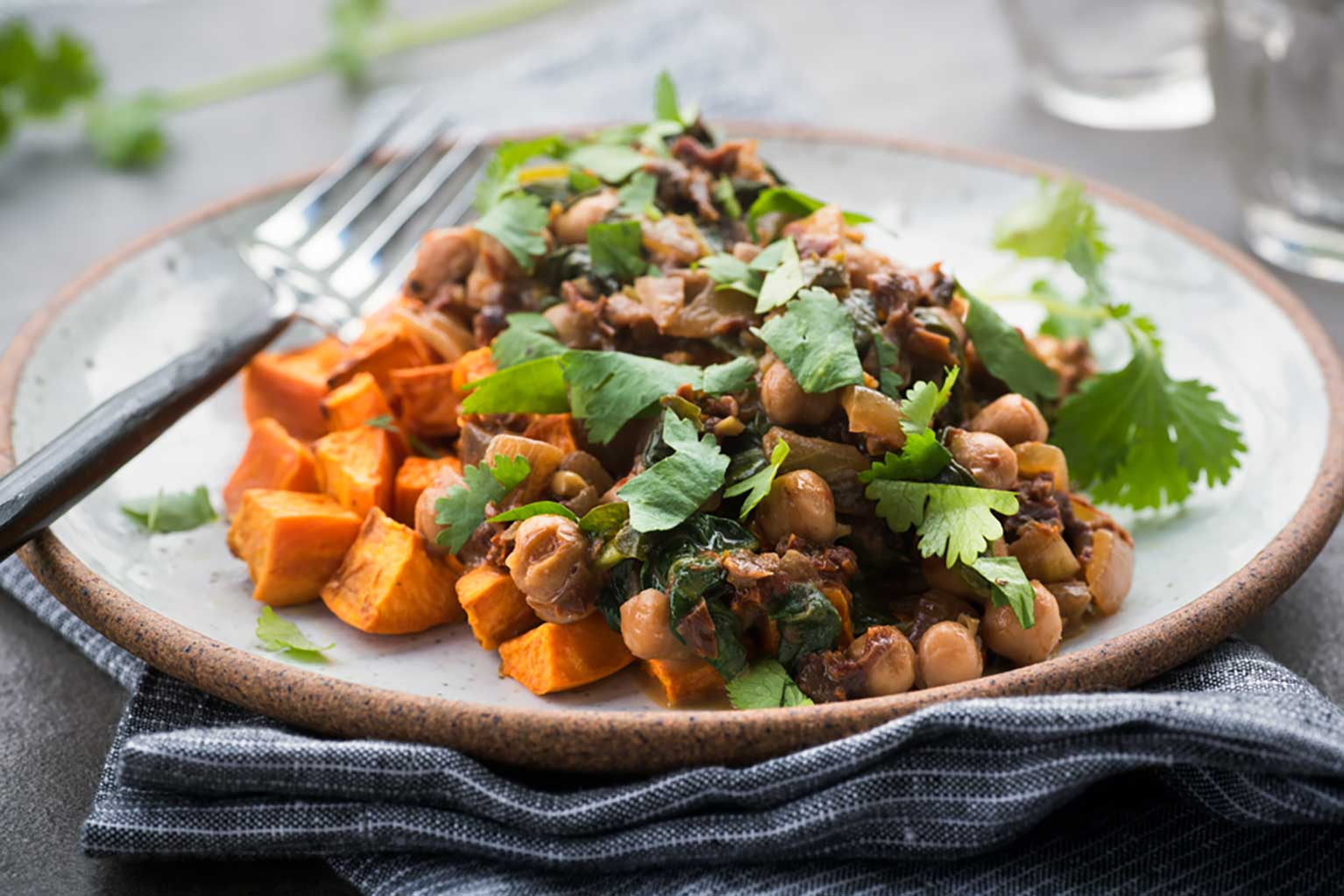 Sweet-potatoes-and-chickpea-meal-topped-with-cilantro-on-a-plate