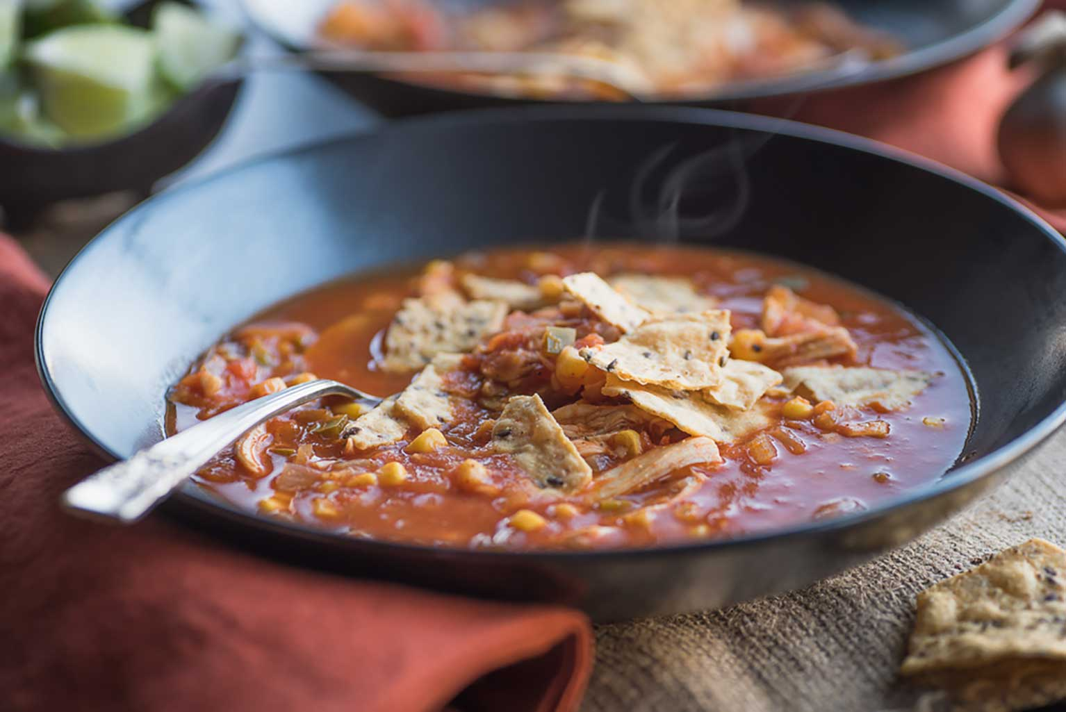 Chicken-tortilla-soup-with-corn-in-a-bowl-with-a-spoon