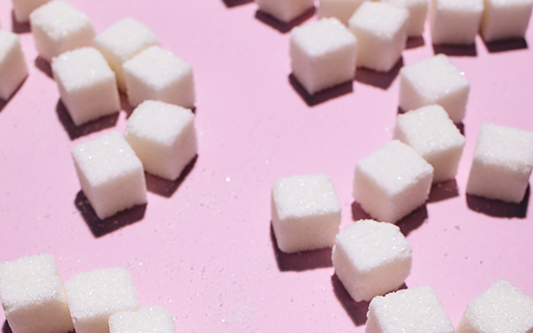 sugar cubes on a pink background