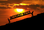 Two people carrying the words Interest Rate