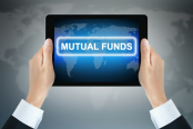 Hands holding mutual funds tablet