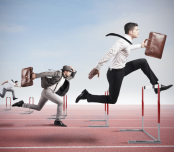 Businessmen Jumping Hurdles