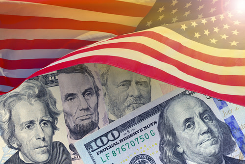 U.S. President on Dollar Bills Under U.S. Flag
