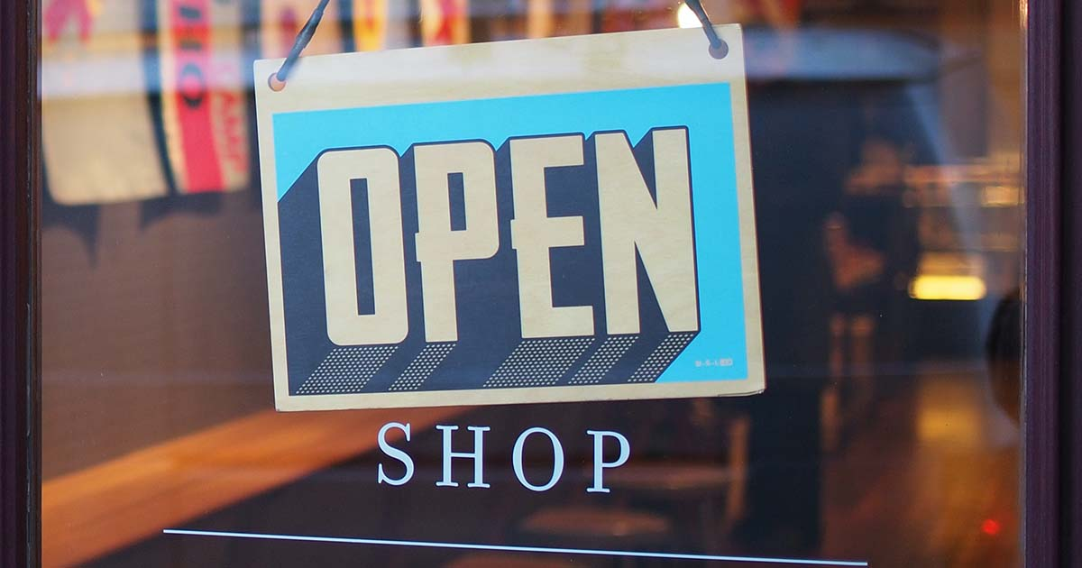 A shop sign saying open