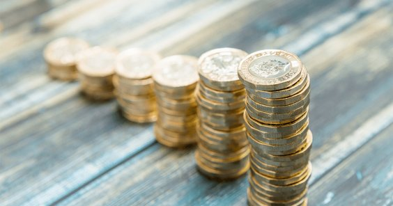 pound coins stacked in ascending stack