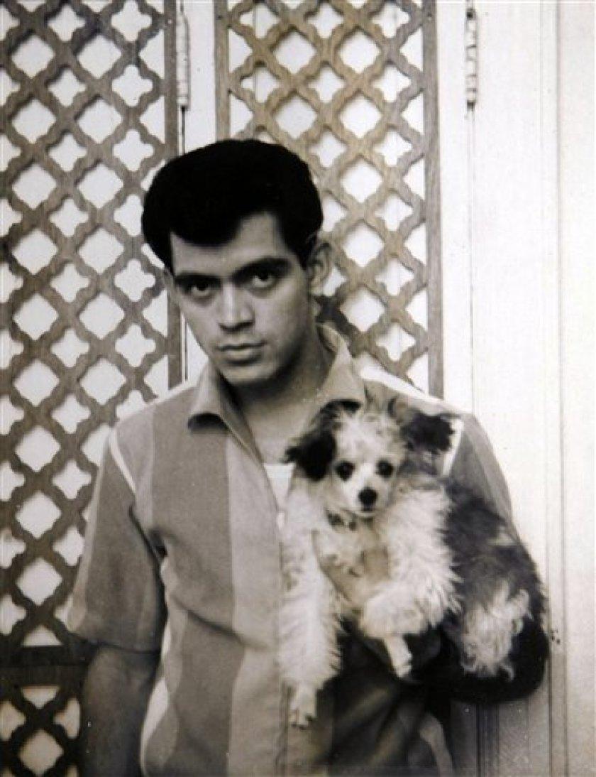 Photo of Raymond Castro holding a dog