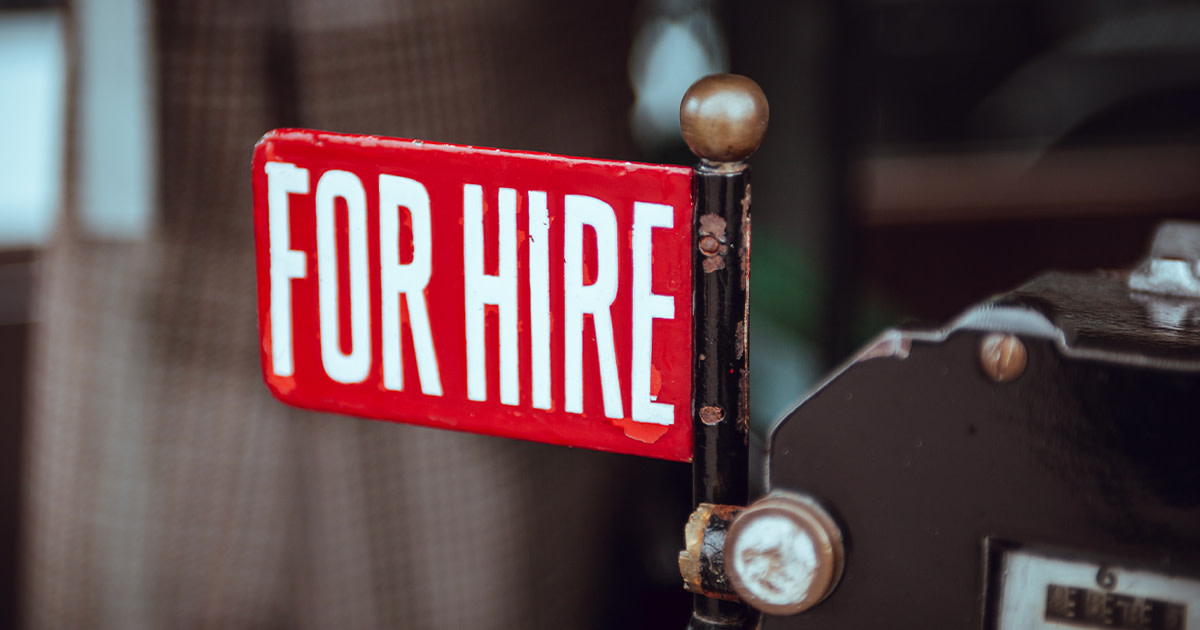 """A red sign that says """"FOR HIRE"""""""