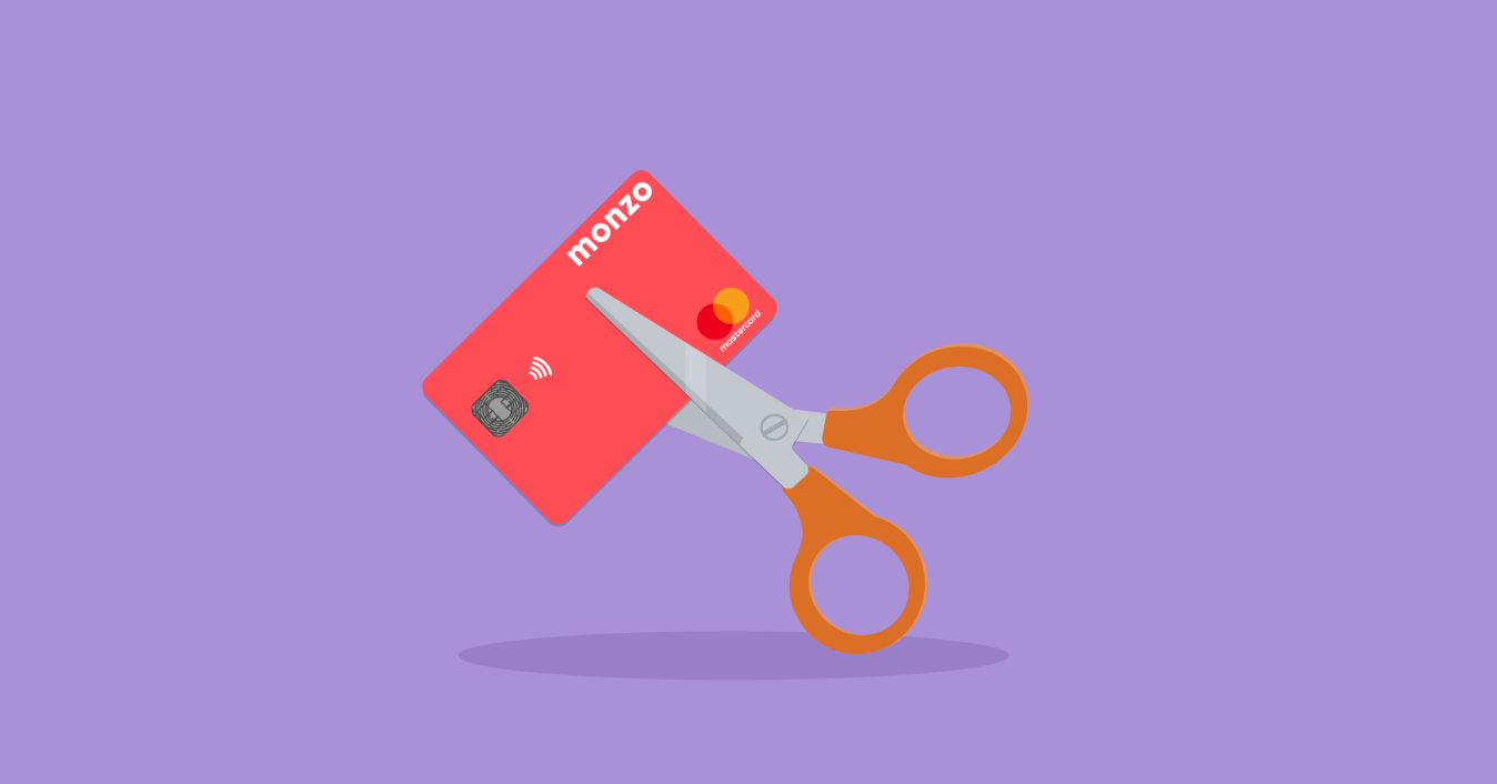 Illustration showing scissors cutting up a Monzo card
