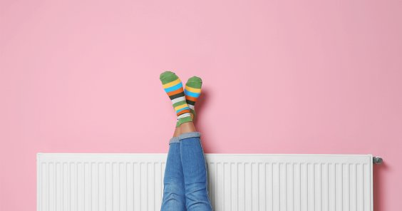 pink wall radiator girl with feet in air