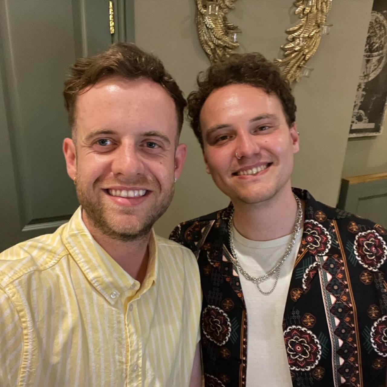 Selfie of two men wearing shirts
