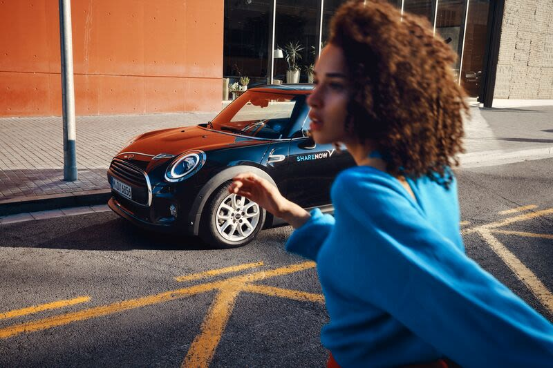 Girl walking by a MINI