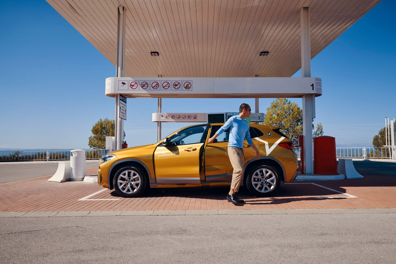 Man Fuelling a BMW X2 Large