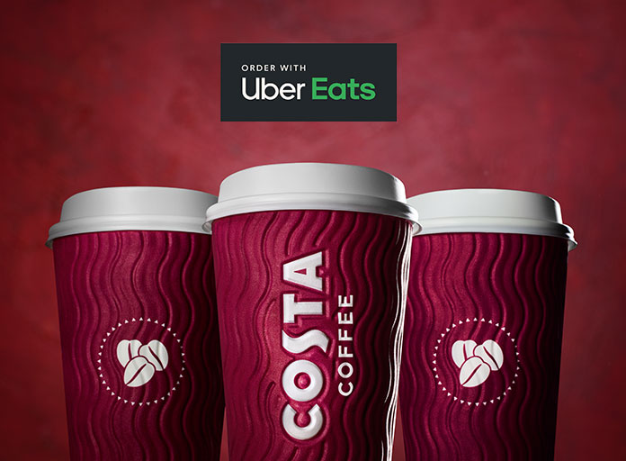 Costa Coffee takeaway cups with Uber Eats logo