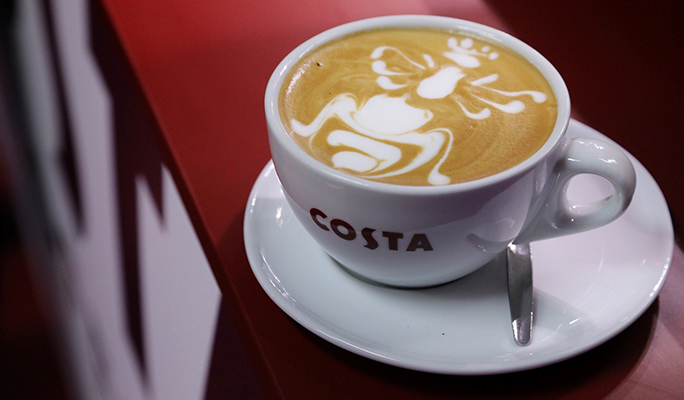 Costa Coffee latte with latte art bumble been design