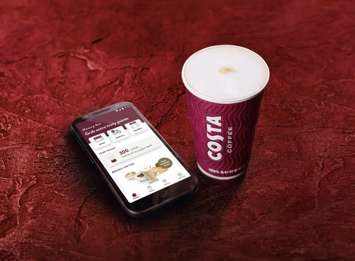 Costa Coffee take away cup with a mobile phone displaying the Costa Coffee app