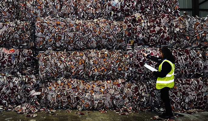 Costa Coffee take away cups at a recycling facility being audited by a recycling officer