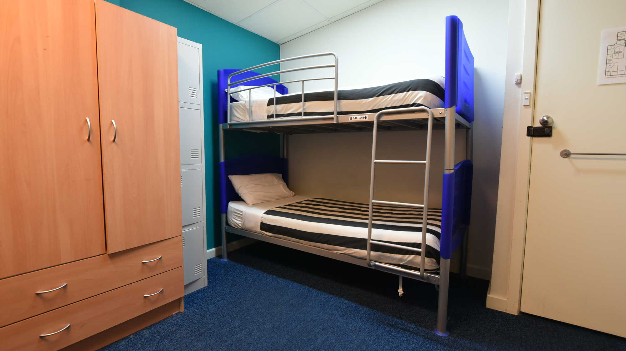 single-bed-in-male-dormitory-room-1