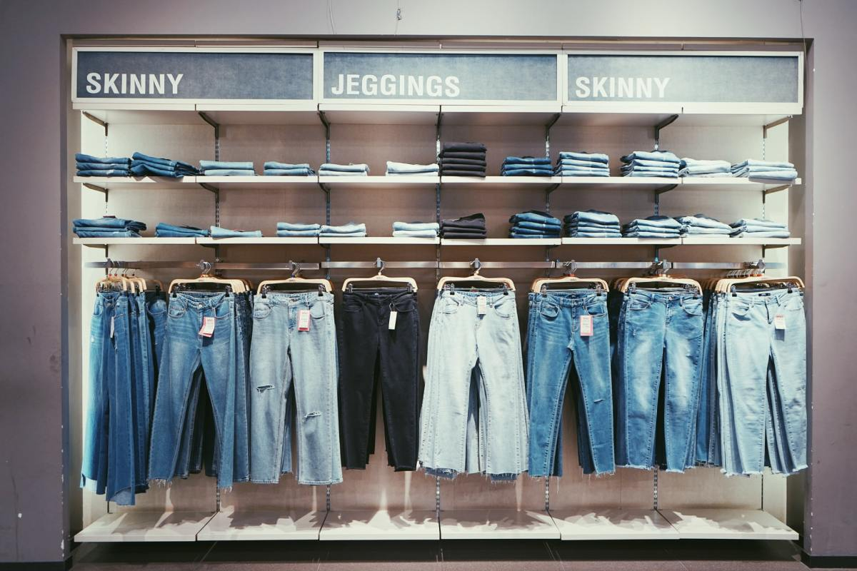 rack of different kinds of jeans