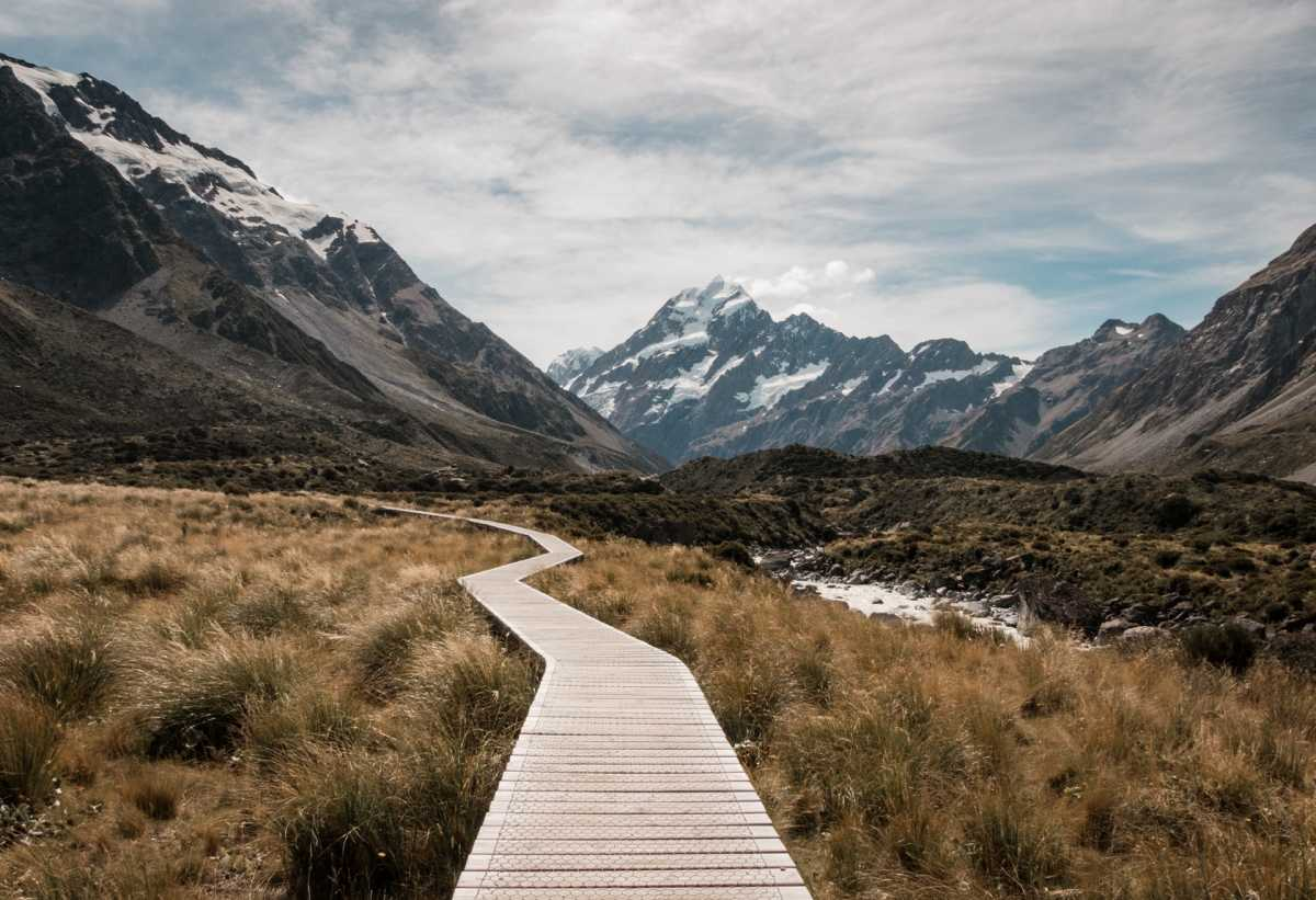 A boardwalk running through a mountainous valley.
