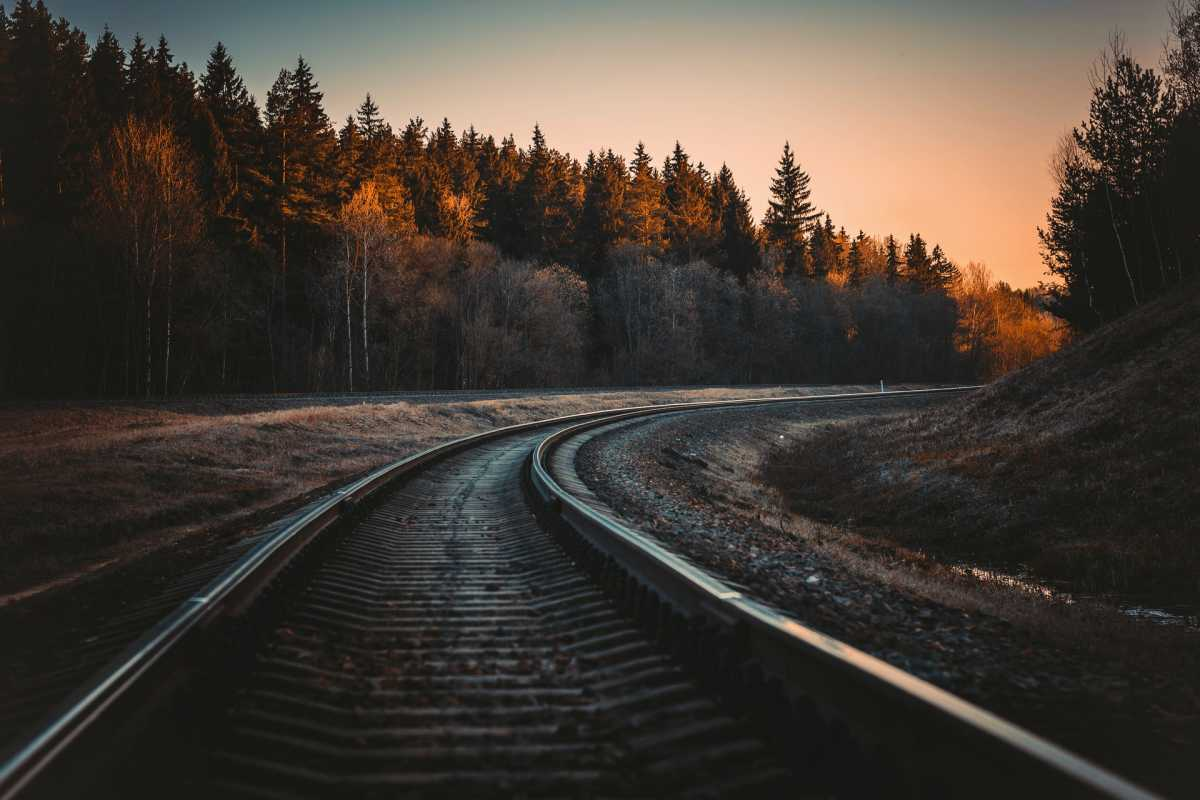 Railroad tracks curving around a bend