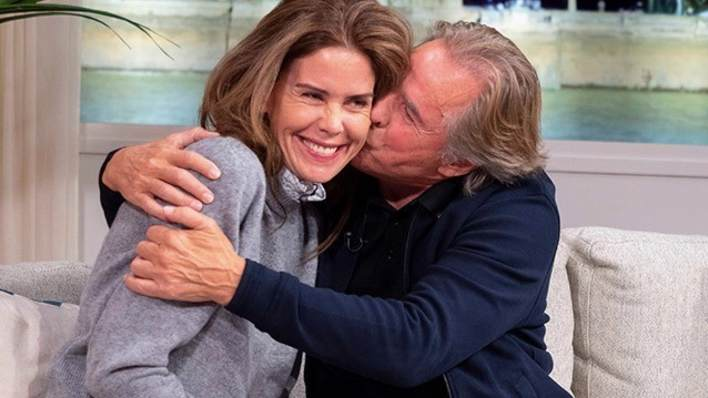 Don Johnson kisses wife Kelley... on the telly!