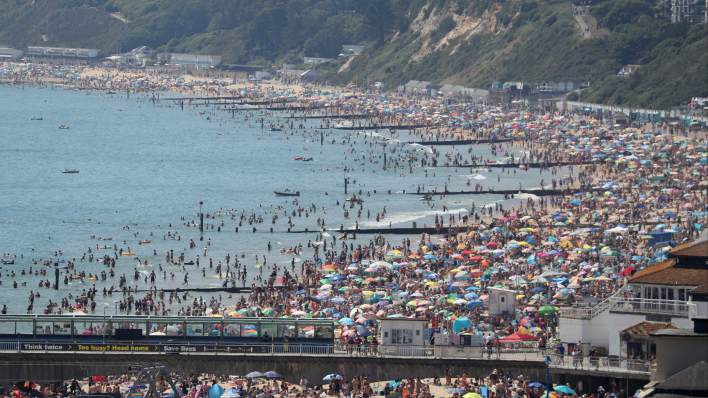 Crowds gather on the beach in Bournemouth as Thursday could be the UK's hottest day of the year with scorching temperatures forecast to rise even further. PA image.