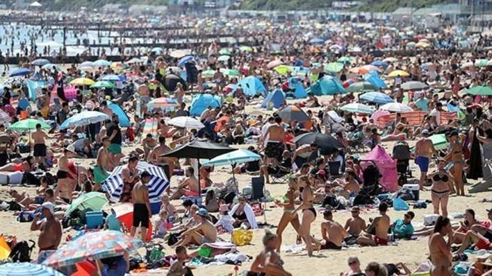 People on the beach in Bournemouth, Dorset, as the public are being reminded to practice social distancing following the relaxation of the coronavirus lockdown restrictions in England