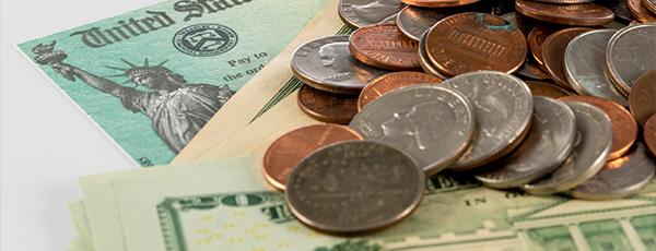 Americans Spending Stimulus Check on Bills, Debt